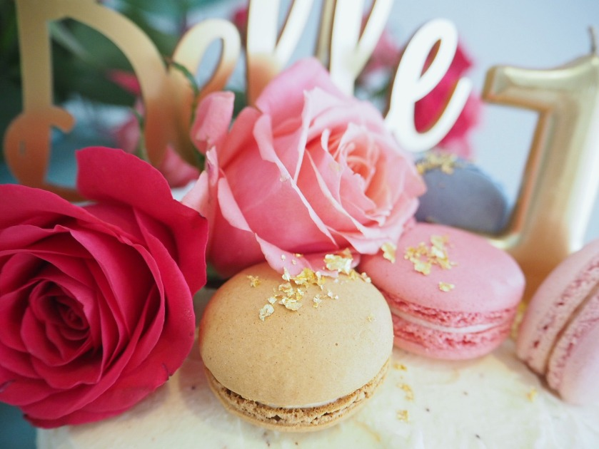 Decorating A Cake With Macarons