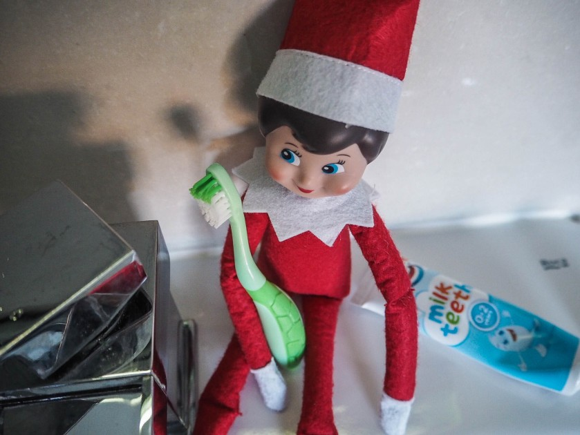 elf on the shelf cleaning her teeth