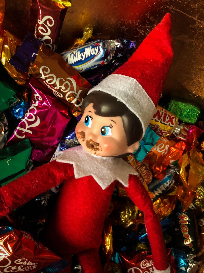 elf on the shelf eating chocolate