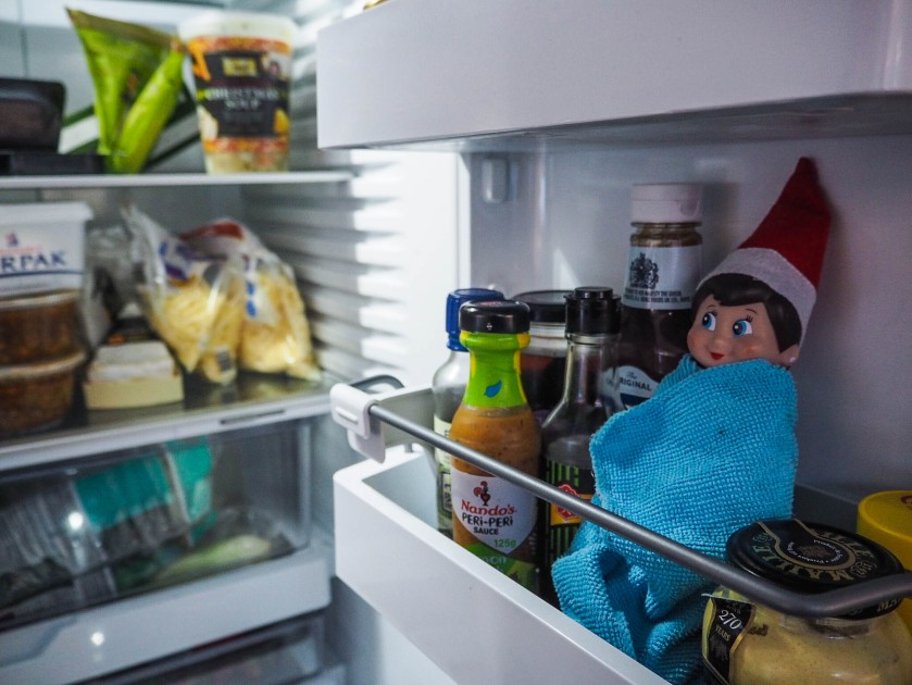 elf on the shelf in the fridge